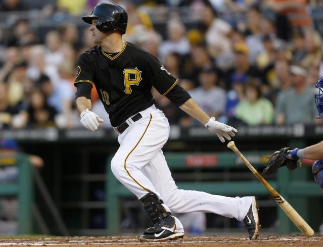 Pittsburgh Pirates' Jordy Mercer (10) hits a double to drive in two runs against the New York Mets in the fourth inning of the baseball game on Friday, June 27, 2014, in Pittsburgh. (AP Photo/Keith Srakocic)