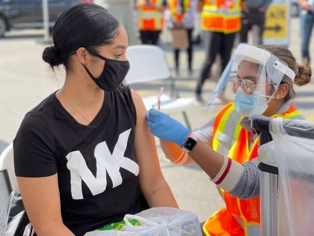 A person receives a COVID-19 vaccine dose through the Vax Van, a mobile vaccination clinic run by Peel Region, at Westwood Square Mall in Mississauga on Sept. 16, 2021. (Chris Glover/CBC - image credit)