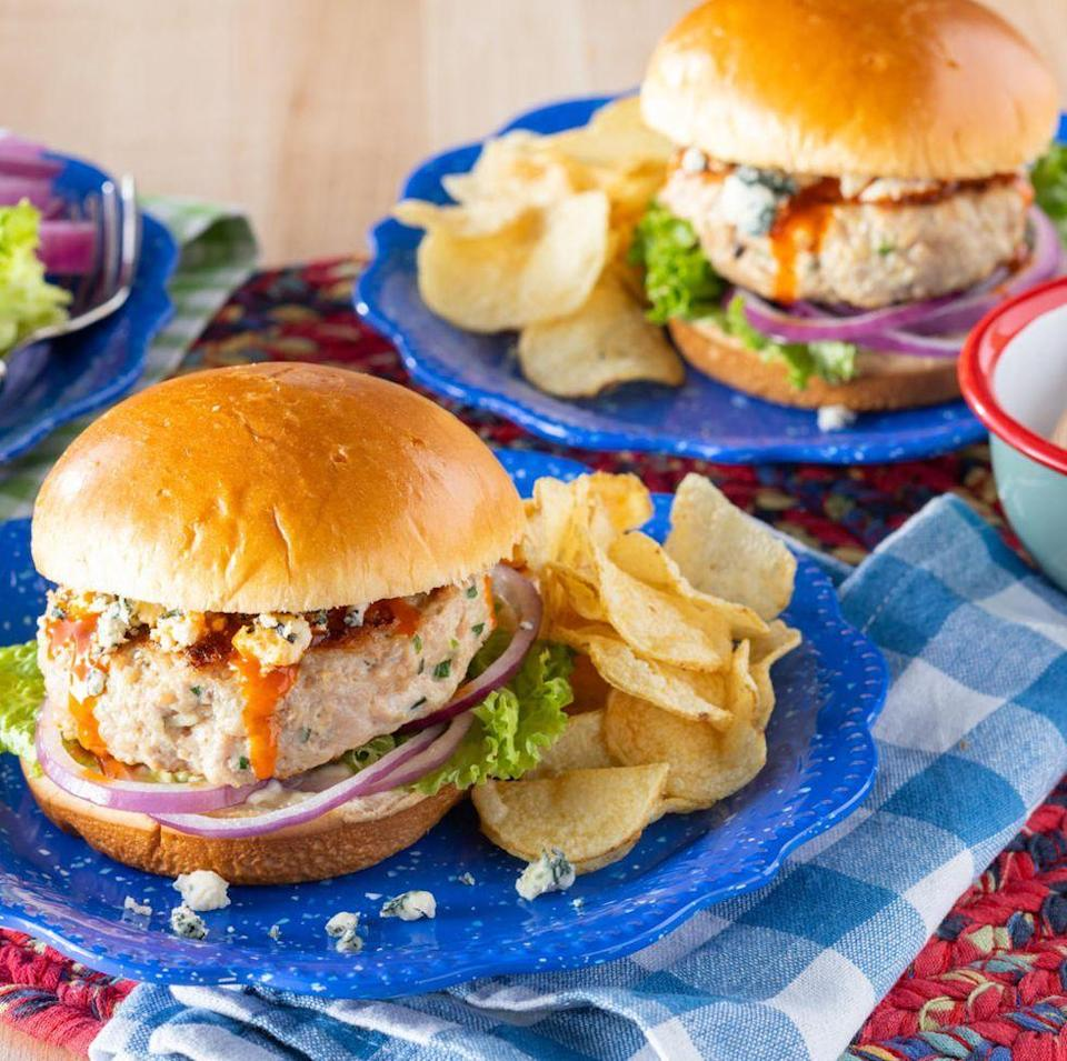 """<p>Chicken burgers might seem finicky, but they're actually easy to make. Plus, dad will love these topped with buffalo sauce and blue cheese, just like game-day wings.</p><p><a href=""""https://www.thepioneerwoman.com/food-cooking/recipes/a35823574/chicken-burgers-recipe/"""" rel=""""nofollow noopener"""" target=""""_blank"""" data-ylk=""""slk:Get the recipe."""" class=""""link rapid-noclick-resp""""><strong>Get the recipe. </strong></a></p><p><a class=""""link rapid-noclick-resp"""" href=""""https://go.redirectingat.com?id=74968X1596630&url=https%3A%2F%2Fwww.walmart.com%2Fsearch%2F%3Fquery%3Dpioneer%2Bwoman%2Bplates&sref=https%3A%2F%2Fwww.thepioneerwoman.com%2Ffood-cooking%2Fmeals-menus%2Fg36109352%2Ffathers-day-dinner-recipes%2F"""" rel=""""nofollow noopener"""" target=""""_blank"""" data-ylk=""""slk:SHOP PLATES"""">SHOP PLATES</a></p>"""