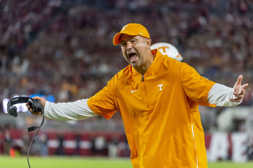 FILE - In this Oct. 19, 2019, file photo, Tennessee head coach Jeremy Pruitt yells at the officials during an NCAA college football game against Alabama in Tuscaloosa, Ala. The SEC came into this season with a contingency plan to deal with coronavirus-related issues. Obviously, we cant predict the future, Tennessee coach Jeremy Pruitt said. I believe we all knew when we started this, that there were no guarantees. (AP Photo/Vasha Hunt, File)