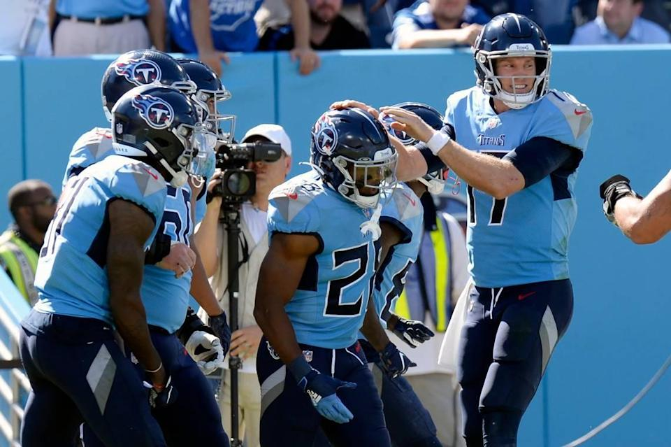 Tennessee Titans running back Jeremy McNichols, center, is congratulated by quarterback Ryan Tannehill, right, after they teamed up for a 10-yard touchdown pass against the Indianapolis Colts on Sunday in Nashville, Tenn.