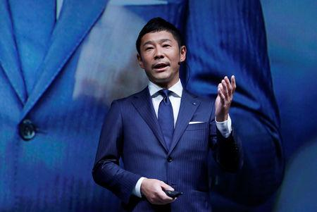 FILE PHOTO: Yusaku Maezawa, the chief executive of Zozo, which operates Japan's popular fashion shopping site Zozotown and is officially called Start Today Co, speaks at an event launching the debut of its formal apparel items, in Tokyo, Japan, July 3, 2018. REUTERS/Kim Kyung-Hoon