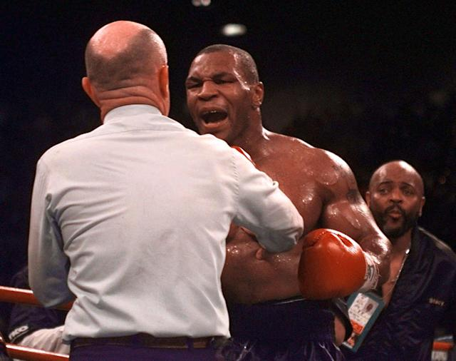 <p>Mike Tyson reacts to referee Mills Lane after Lane stopped the fight against Evander Holyfield in the third round of their WBA Heavyweight match after Tyson bit Holyfield's ear for the second time Saturday, June 28, 1997, at the MGM Grand in Las Vegas. Holyfield retained his title. (AP Photo/Lenny Ignelzi) </p>