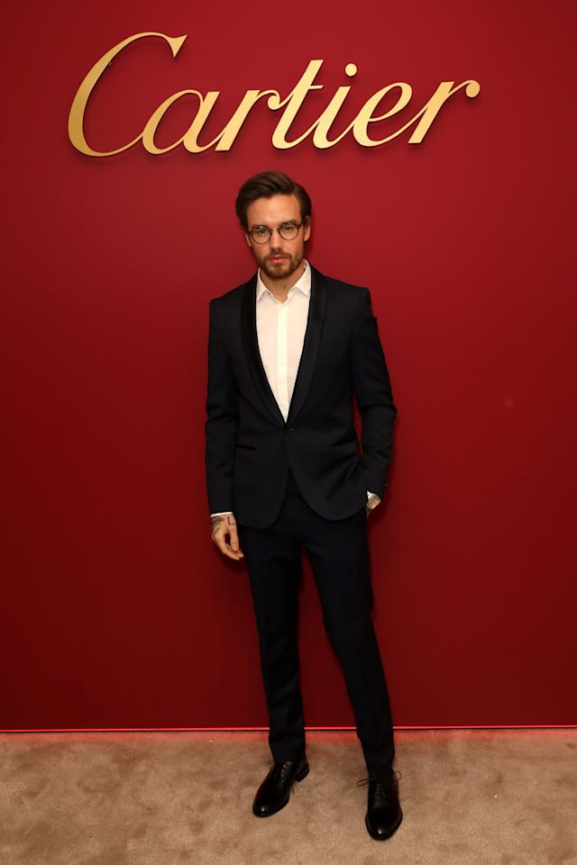 <p>The singer paired a black suit with a white shirt and glasses at the event. <em>[Photo: Getty]</em> </p>