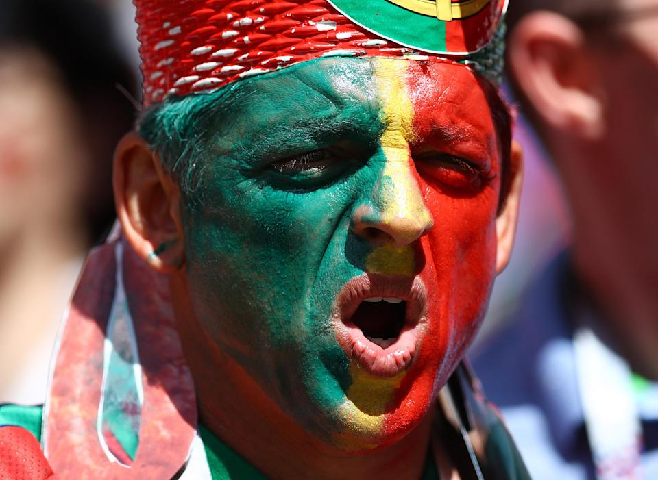 <p>Face paint was the order of the day for thousands of fans, including this Portugal supporter. (Getty) </p>