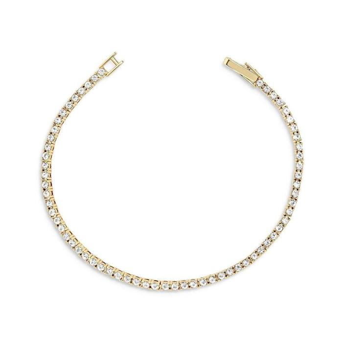 """<p><strong>BaubleBar</strong></p><p>baublebar.com</p><p><strong>$48.00</strong></p><p><a href=""""https://go.redirectingat.com?id=74968X1596630&url=https%3A%2F%2Fwww.baublebar.com%2Fproduct%2F57445-bennett-bracelet%3Fsku%3D56881&sref=https%3A%2F%2Fwww.elle.com%2Ffashion%2Fshopping%2Fg23654253%2Fbest-gifts-under-50-ideas%2F"""" rel=""""nofollow noopener"""" target=""""_blank"""" data-ylk=""""slk:Shop Now"""" class=""""link rapid-noclick-resp"""">Shop Now</a></p><p>A real diamond tennis bracelet is out of your budget, but this is the next best thing. </p>"""