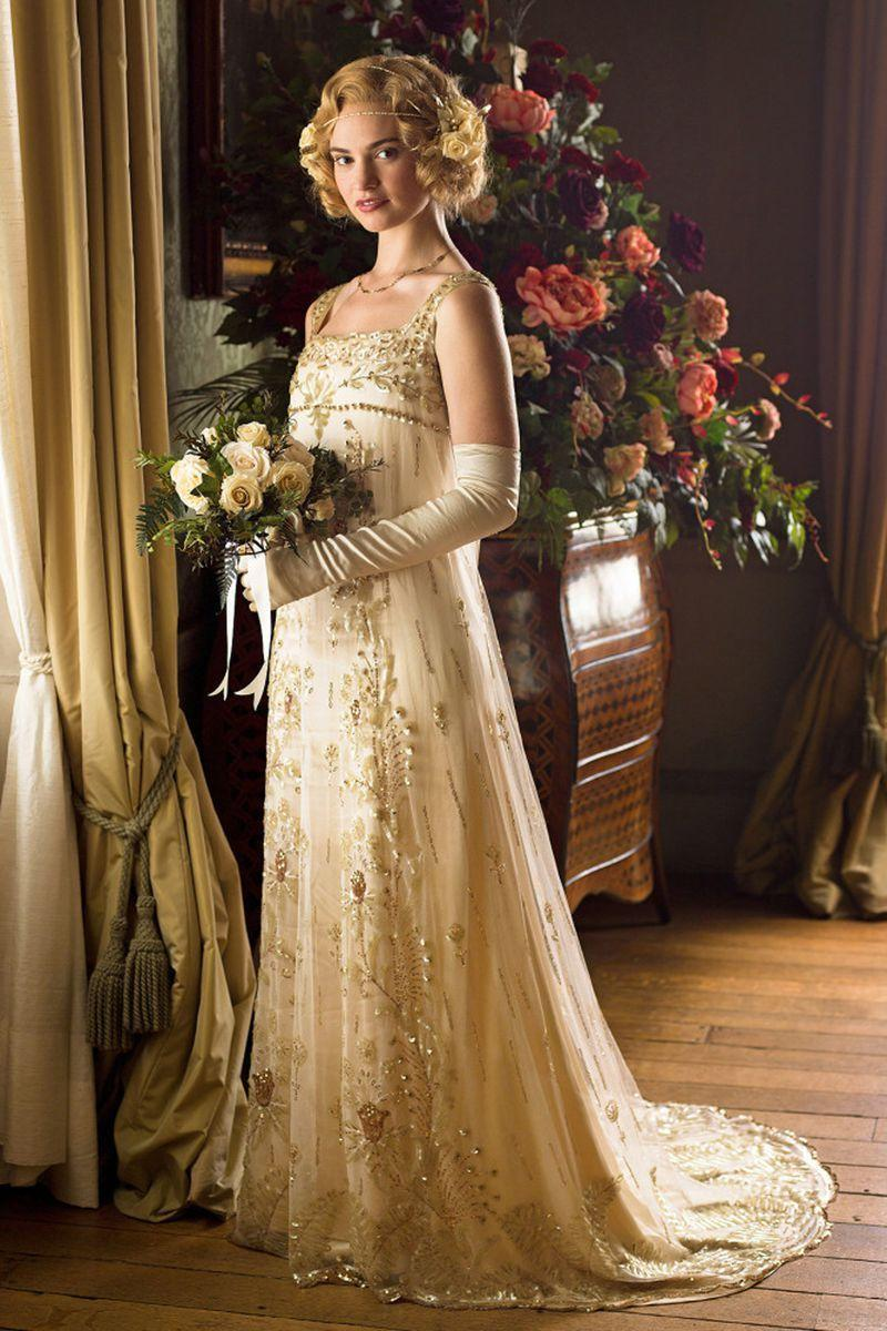 """<p><span class=""""redactor-unlink"""">Rose married aristocrat Atticus Aldridge</span> in a glamorous beaded and silk tulle gown in season 5. <em>Downton Abbey</em>'s costume designer Anna Mary Scott Robbins said it was 100 years old. """"It was just a ghost of a dress, and I stumbled upon it,"""" she <a href=""""http://www.pbs.org/wgbh/masterpiece/programs/features/slideshow/downton-abbey-s5-e8-bts-rose-wedding-dress/"""" rel=""""nofollow noopener"""" target=""""_blank"""" data-ylk=""""slk:told PBS"""" class=""""link rapid-noclick-resp"""">told PBS</a>. """"A trader I'd made friends with has a little shop in London, and he actually kept it in a box — it had never been worn.""""</p>"""