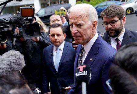 FILE PHOTO: Former Vice President Joe Biden who is mulling a 2020 presidential candidacy, speaks to the media after speaking at the International Brotherhood of Electrical Workers' (IBEW) construction and maintenance conference in Washington, U.S., April 5, 2019. REUTERS/Joshua Roberts/Files