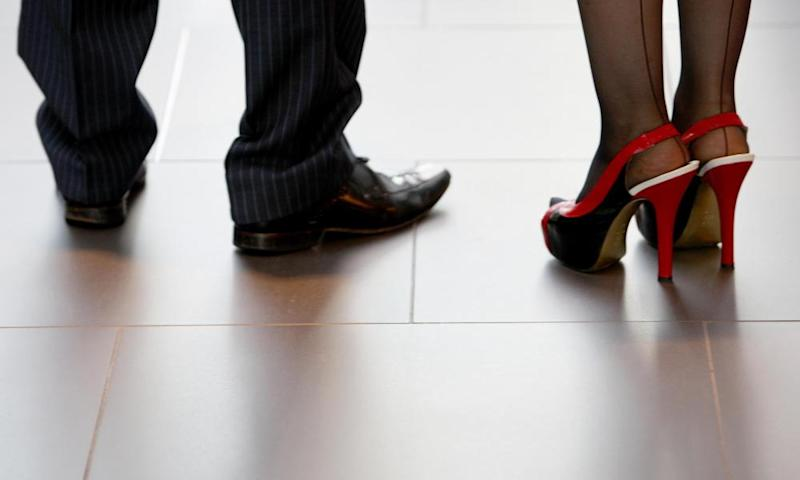 A man in black shoes and a woman in high heels.