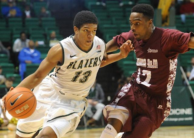 UAB's Chad Frazier, left, works against the pressure of Alabama A&M's Green Hill during the first half of an NCAA college basketball game in Birmingham, Ala., Sunday, Dec. 29, 2013. UAB won 69-57. (AP Photo/AL.com, Mark Almond)