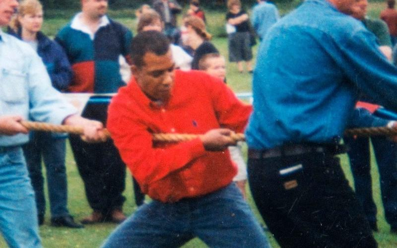 Khalid Masood is seen here taking part in a village fete tug-of-war - Julian Simmonds