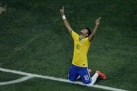 Brazil's Neymar celebrates his goal against Croatia during their 2014 World Cup opening match at the Corinthians arena in Sao Paulo June 12, 2014. REUTERS/Fabrizio Bensch