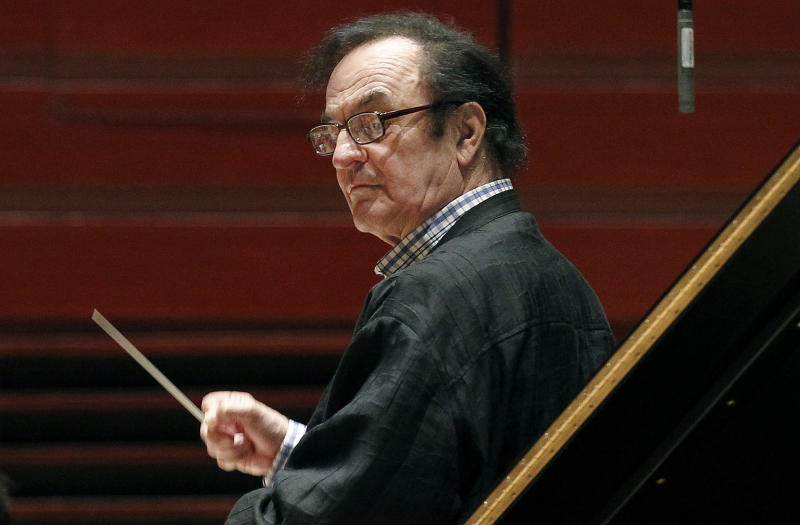 FILE - In this Oct. 19, 2011 file photo, chief conductor Charles Dutoit rehearses with the Philadelphia Orchestra in Philadelphia. Six more women have stepped forward to accuse the prominent conductor of sexually assaulting them in the United States, France and Canada, including a musician who says the maestro raped her in 1988. (AP Photo/Alex Brandon, File)