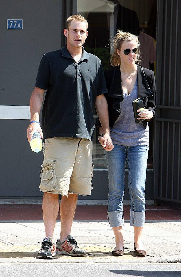 "Andy Roddick and his fiancee, model Brooklyn Decker, enjoy a stroll in Wimbledon, London. Hopefully the tennis star can capture the title (and $1.5 million purse). Robinson/MacFarlane/<a href=""http://www.splashnewsonline.com/"" target=""new"">Splash News</a> - June 23, 2008"