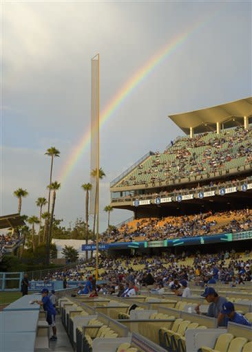 A rainbow is seen over the right field bleachers at Dodger Stadium prior to the Dodgers' baseball game against the Arizona Diamondbacks, Thursday, Aug. 30, 2012, in Los Angeles. (AP Photo/Mark J. Terrill)