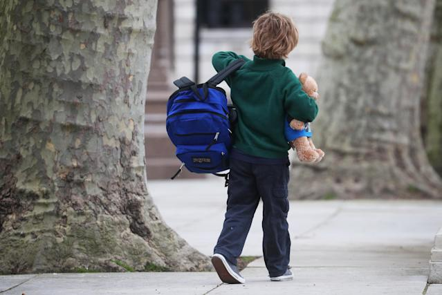 A child walking to school in London on Wednesday morning. (REUTERS/Hannah McKay)
