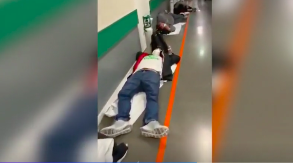 Sick patients are seen lying on towels and coats on the floor as they wait to be seen at the emergency ward in the Infanta Leonor Hospital in Madrid. (Newsflash)