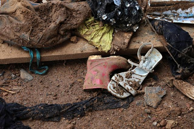 <p>Shoes left after a flash flood during the mudslide at Pentagon, in Freetown, Sierra Leone on Aug. 18, 2017. (Photo: Afolabi Sotunde/Reuters) </p>