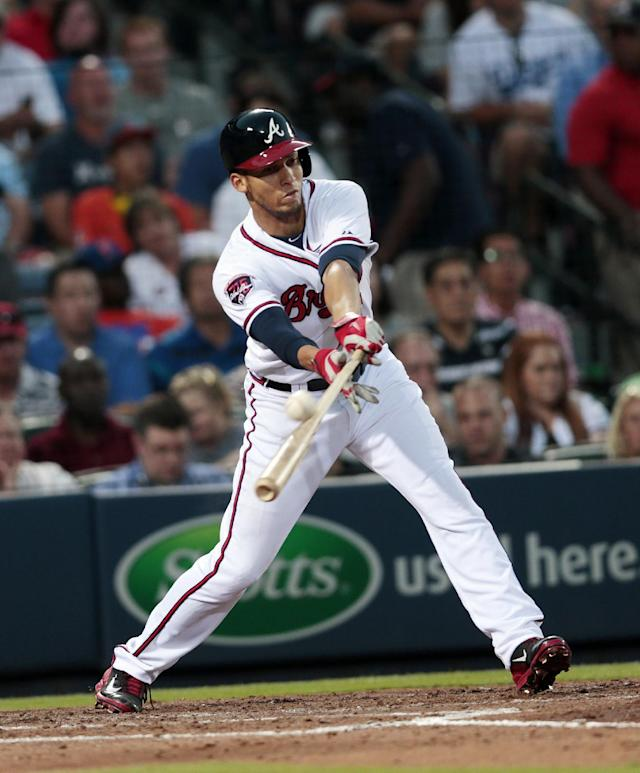 Atlanta Braves shortstop Andrelton Simmons drives in a run with a base hit in the fourth inning of a baseball game against the Los Angeles Dodgers Wednesday, Aug. 13, 2014, in Atlanta. (AP Photo/John Bazemore)
