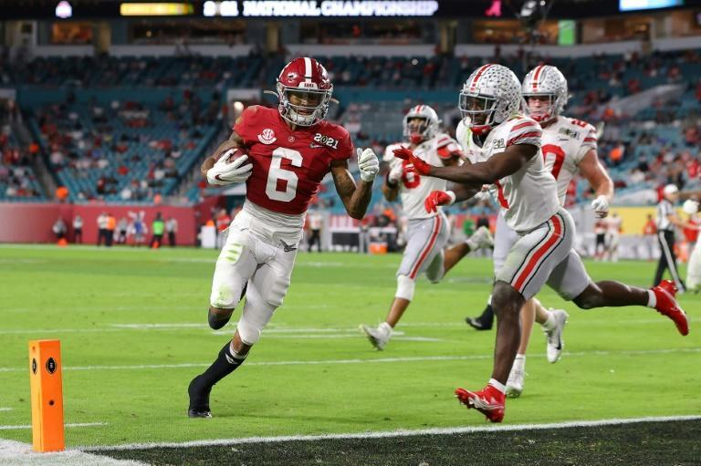 The University of Alabama's Heisman Trophy winner DeVonta Smith scores a touchdown in the Crimson Tide's victory over Ohio State University in the 2020 College Football Playoffs championship game