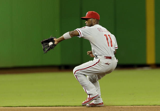 Philadelphia Phillies shortstop Jimmy Rollins (11) fields a ground ball hit by Miami Marlins' Donovan Solano in the fourth inning of a baseball game, Monday, Sept. 23, 2013, in Miami. (AP Photo/Alan Diaz)