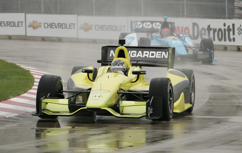 IndyCar driver Josef Newgarden leads Simon Pagenaud of France during the IndyCar practice on Belle Isle in Detroit, Friday, June 1, 2012. (AP Photo/Dave Frechette)