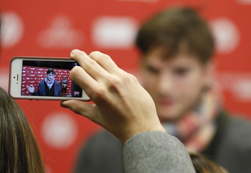 "Actor Ashton Kutcher, who portrays Apple's Steve Jobs in the movie ""jOBS,"" is photographed on an Apple iPhone while being interviewed at the premiere of the film during the 2013 Sundance Film Festival on Friday, Jan. 25, 2013 in Park City, Utah. (Photo by Danny Moloshok/Invision/AP)"