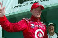 FILE - In this Sunday, March 2, 2003, file photo, Scott Dixon waves to the crowd after winning the Toyota Indy 300 race in Homestead, Fla. This was Dixon's first IRL race and victory. Dixon will race for a sixth IndyCar championship Sunday in the season finale on the streets of downtown St. Petersburg, where even an uncharacteristically poor finish would win Dixon the title.(AP Photo/Terry Renna, File)