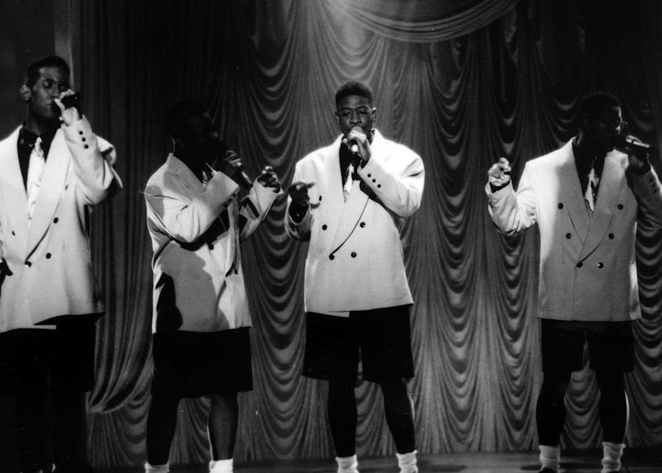 <p>Boyz II Men took the stage for one of their concerts wearing matching white tuxedo jackets and black knee high shorts.</p>