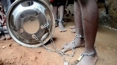 People with chained legs are pictured after being rescued from a building in the northern city of Kaduna