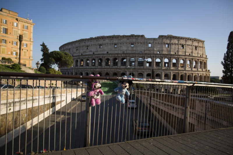 Mickey puppets are seen attached to a railing with the Colosseum in the background in Rome, on March 20, 2020 during the country's lockdown within the new coronavirus crisis.Italy imposed the closure of all stores except for pharmacies and food shops in a desperate bid to control the deadly COVID-19 coronavirus that has killed 4032 till now. (Photo by Christian Minelli/NurPhoto via Getty Images)