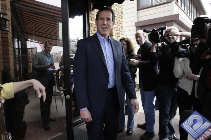 Republican presidential candidate, former Pennsylvania Sen. Rick Santorum, talks to reporters while campaigning in West Bend, Wis., Sunday, April 1, 2012. (AP Photo/Jae C. Hong)