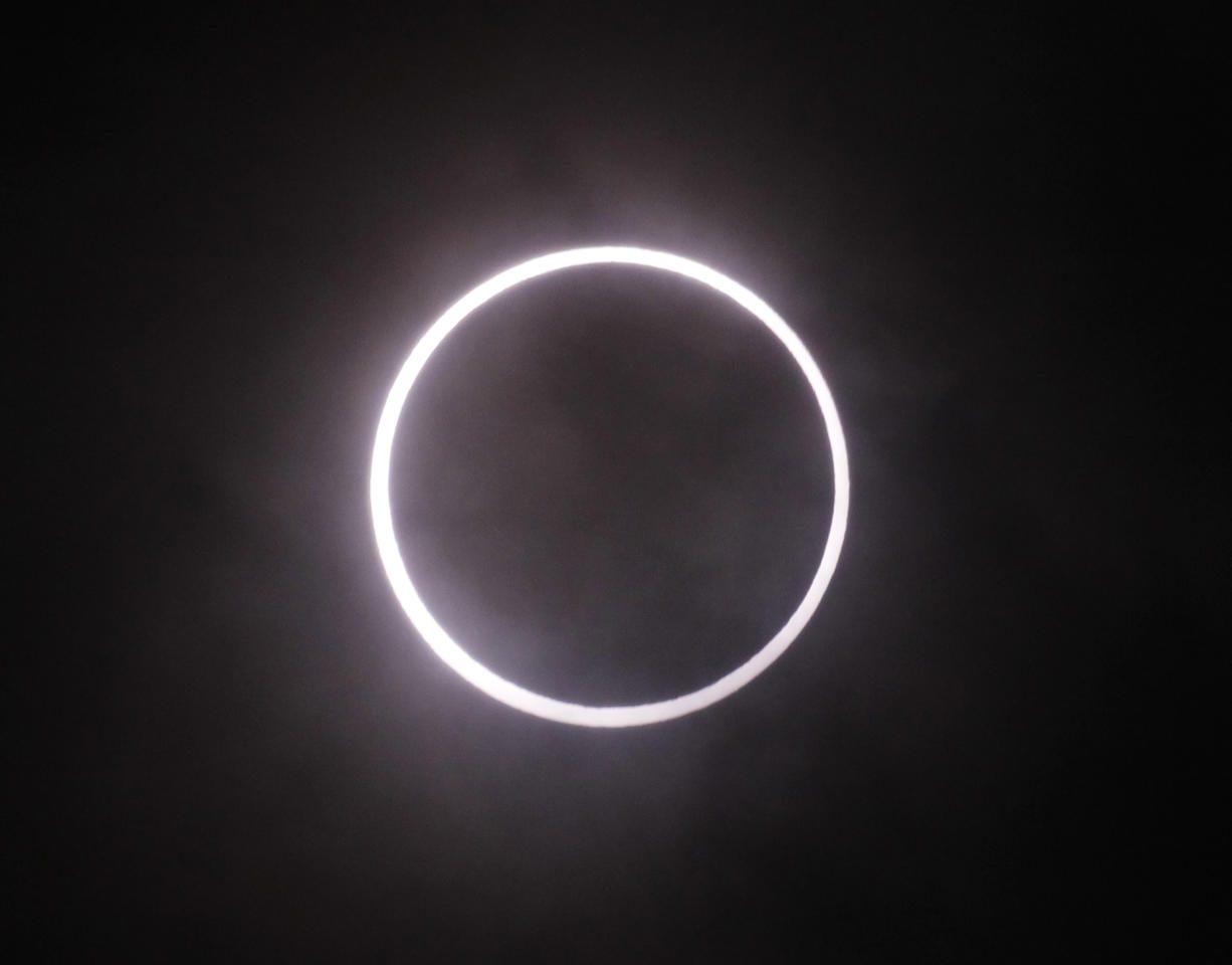 An annular solar eclipse is seen in the sky over Yokohama near Tokyo Monday, May 21, 2012. The annular solar eclipse, in which the moon passes in front of the sun leaving only a golden ring around its edges, was visible to wide areas across the continent Monday morning. (AP Photo/Koji Sasahara)