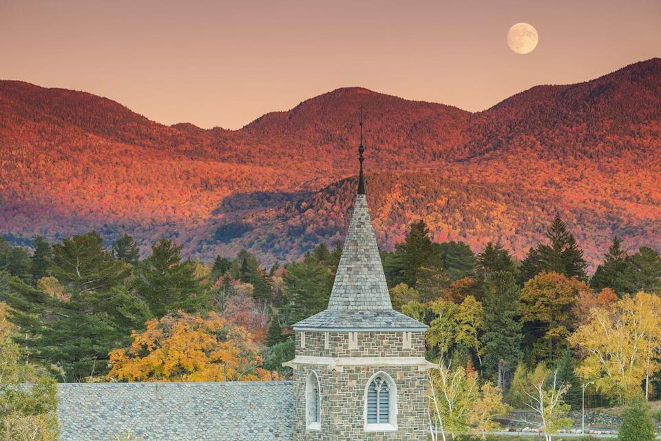 """<p>Now that's a sunset! Somehow, the <a href=""""https://fave.co/2Q9fZdy"""" rel=""""nofollow noopener"""" target=""""_blank"""" data-ylk=""""slk:Adirondack Mountains"""" class=""""link rapid-noclick-resp"""">Adirondack Mountains</a> in New York become even more beautiful in the <a href=""""https://www.countryliving.com/life/g1897/fall-quotes/"""" rel=""""nofollow noopener"""" target=""""_blank"""" data-ylk=""""slk:autumn season"""" class=""""link rapid-noclick-resp"""">autumn season</a>. </p>"""