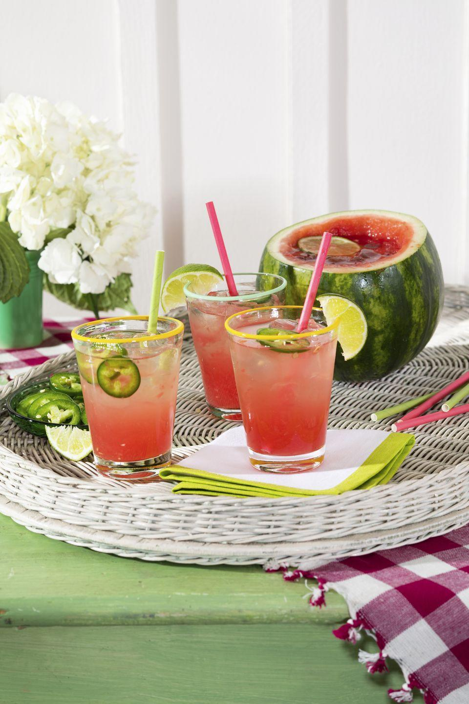 """<p>The jalapeño-infused liquor gives this margarita just enough warmth to keep guests sipping, while the watermelon keeps it refreshing.</p><p><strong><a href=""""https://www.countryliving.com/food-drinks/a36301146/spicy-watermelon-cocktail/"""" rel=""""nofollow noopener"""" target=""""_blank"""" data-ylk=""""slk:Get the recipe"""" class=""""link rapid-noclick-resp"""">Get the recipe</a>.</strong></p>"""