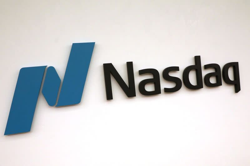 Nasdaq hits record high as U.S. economy shows signs of rebound