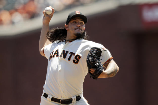 San Francisco Giants starting pitcher Dereck Rodriguez throws to the San Francisco Giants during the first inning of a baseball game Sunday, June 24, 2018, in San Francisco. (AP Photo/Marcio Jose Sanchez)