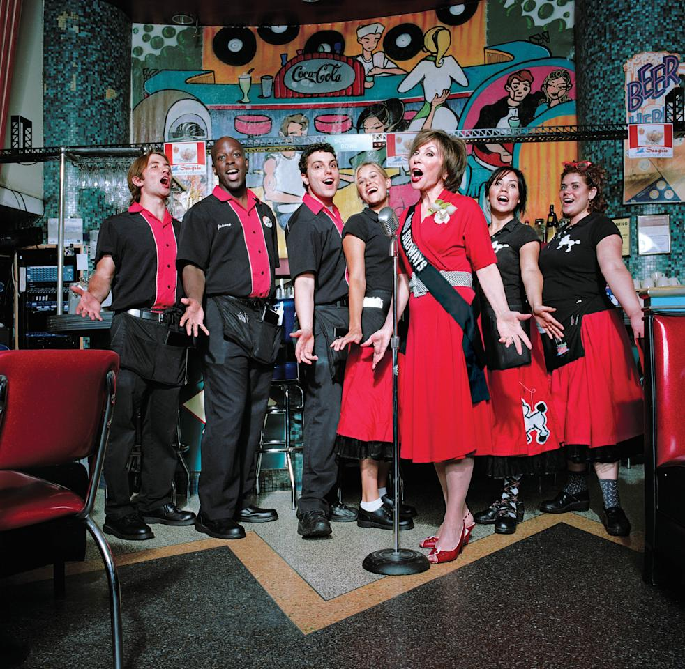 "This 2007 photo provided by Fiona Gardner shows Ellen Hart Sturm, third from right, singing at her restaurant, Ellen's Stardust Diner, on Broadway in New York. Sturm appeared on placards in the New York City subways during March and April of 1959 in the ""Meet Miss Subways"" campaign that ran for 35 years as eye candy to bring attention to other advertisements in New York's transit system. ""Meet Miss Subways: New York's Beauty Queens 1941-76,"" is now an exhibition at the New York Transit Museum running Oct. 23-March 25, and a companion book of the same name with current-day photos of the women by photographer Fiona Gardner. (AP Photo/Fiona Gardner)"