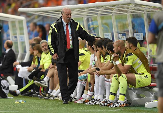 Spain's head coach Vicente Del Bosque greets his bench players during the group B World Cup soccer match between Spain and the Netherlands at the Arena Ponte Nova in Salvador, Brazil, Friday, June 13, 2014.The Netherlands won the match 5-1. (AP Photo/Manu Fernandez)