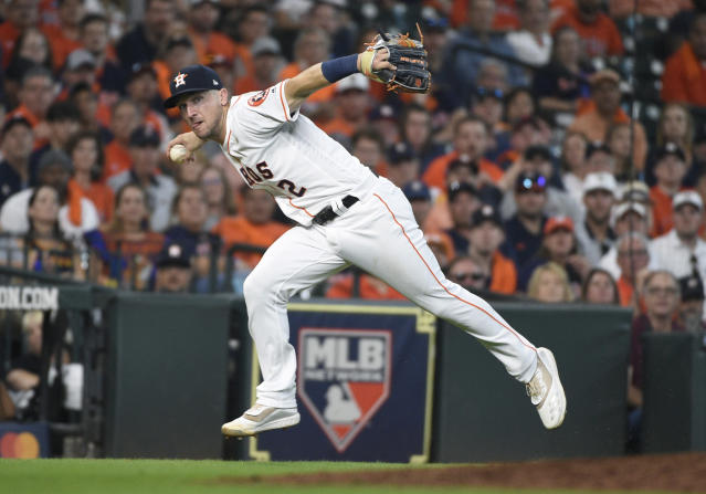FILE - In this Oct. 4, 2019, file photo, Houston Astros third baseman Alex Bregman looks to first after fielding a grounder by Tampa Bay Rays' Tommy Pham, who was safe at first in the seventh inning during Game 1 of a baseball American League Division Series in Houston. If Bregman is the American Leagues Most Valuable Player when the voting is announced Thursday, Nov. 14, the Astros will become the first team to have an MVP, Cy Young Award winner and Rookie of the Year in the same season. Justin Verlander took Cy Young honors, and Yordan Alvarez was picked as the ALs top rookie. AP Photo/Eric Christian Smith, File)