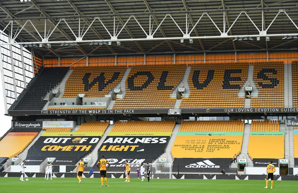 WOLVERHAMPTON, ENGLAND - OCTOBER 04: A general view of the Wolves wording on the seats in the stand during the Premier League match between Wolverhampton Wanderers and Fulham at Molineux on October 04, 2020 in Wolverhampton, England. Sporting stadiums around the UK remain under strict restrictions due to the Coronavirus Pandemic as Government social distancing laws prohibit fans inside venues resulting in games being played behind closed doors. (Photo by Stu Forster/Getty Images)
