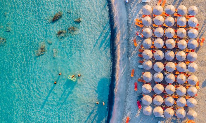 The beautiful beach at Elafonissi in Crete is famous for its soft pink sand. (Getty Images)