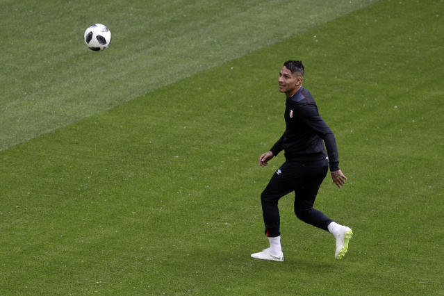 Peru's Paolo Guerrero warms up on the pitch during Peru's official training on the eve of the group C match between Peru and Denmark at the 2018 soccer World Cup in the Mordovia Arena in Saransk, Russia, Friday, June 15, 2018. (AP Photo/Gregorio Borgia)