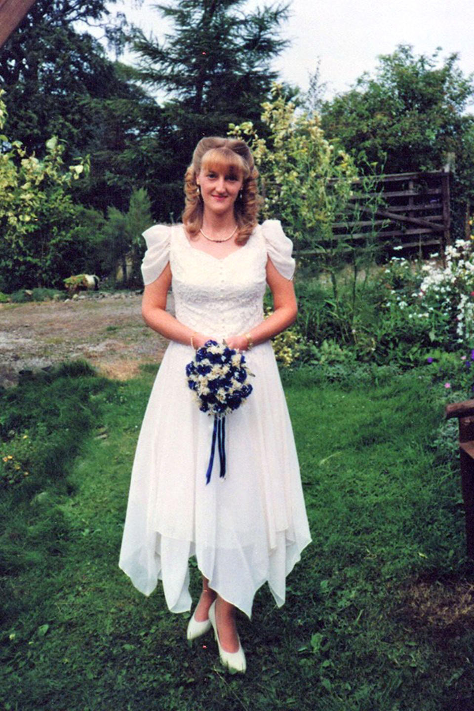 Her mother photographed in the sentimental gown her wedding day [Photo: Caters]