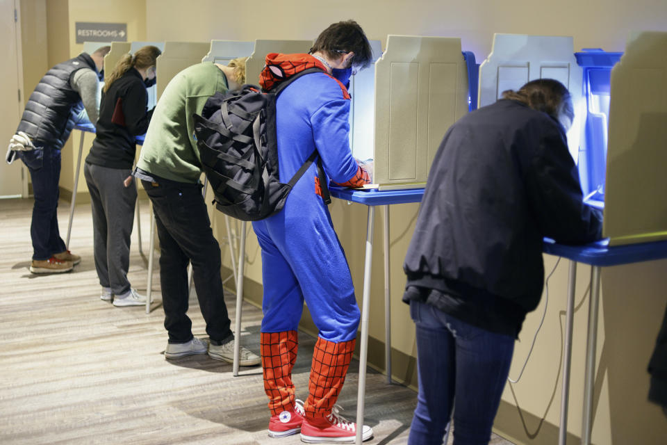 Colin Buckley of Omaha wears a Spiderman suit as he votes early on Halloween, at the Douglas County Election Commision office in Omaha, Neb., Saturday, Oct. 31, 2020. (AP Photo/Nati Harnik)
