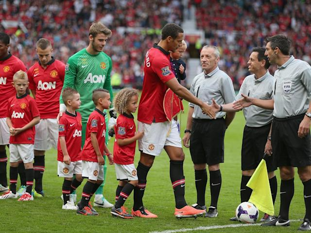 The defender with his three children at his testimonial match (Getty)