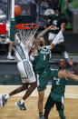 Michigan State's Gabe Brown, left, and Eastern Michigan's Ty Groce (1) vie for a rebound during the second half of an NCAA college basketball game Wednesday, Nov. 25, 2020, in East Lansing, Mich. Michigan State won 83-67. (AP Photo/Al Goldis)