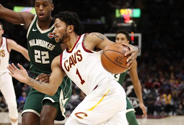 CLEVELAND, OH - NOVEMBER 07: Derrick Rose #1 of the Cleveland Cavaliers drives around Khris Middleton #22 of the Milwaukee Bucks during the second half at Quicken Loans Arena on November 7, 2017 in Cleveland, Ohio. Cleveland won the game 124-119. NOTE TO USER: User expressly acknowledges and agrees that, by downloading and or using this photograph, User is consenting to the terms and conditions of the Getty Images License Agreement. Gregory Shamus/Getty Images/AFPCLEVELAND, OH - NOVEMBER 07: Derrick Rose #1 of the Cleveland Cavaliers drives around Khris Middleton #22 of the Milwaukee Bucks during the second half at Quicken Loans Arena on November 7, 2017 in Cleveland, Ohio. Cleveland won the game 124-119. NOTE TO USER: User expressly acknowledges and agrees that, by downloading and or using this photograph, User is consenting to the terms and conditions of the Getty Images License Agreement. Gregory Shamus/Getty Images/AFP (AFP Photo/Gregory Shamus)