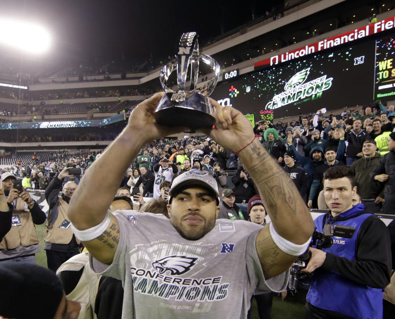Former Philadelphia Eagles linebacker Mychal Kendricks holds the George Halas Trophy after the Eagles won last season's NFC championship