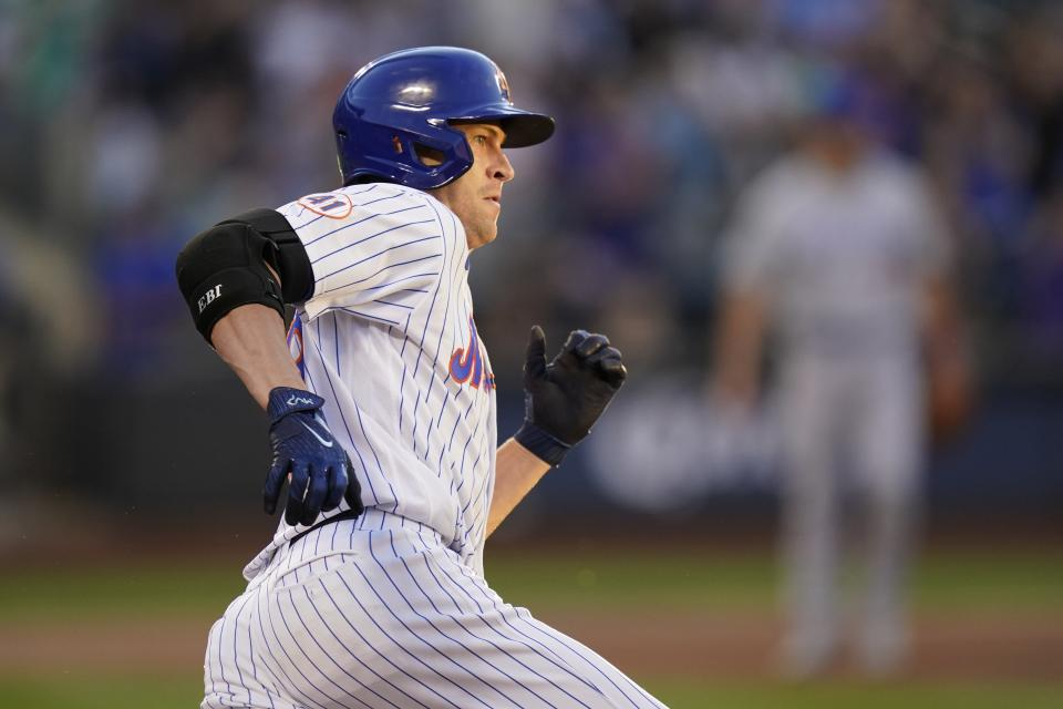 New York Mets' Jacob deGrom rounds first, but stops on an RBI single during the second inning of the team's baseball game against the Chicago Cubs on Wednesday, June 16, 2021, in New York. (AP Photo/Frank Franklin
